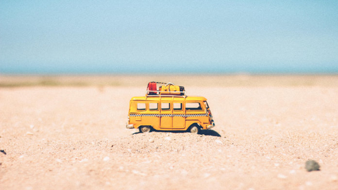 Van toy on the sand
