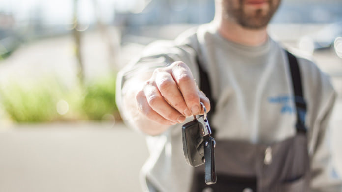 Man with a car key